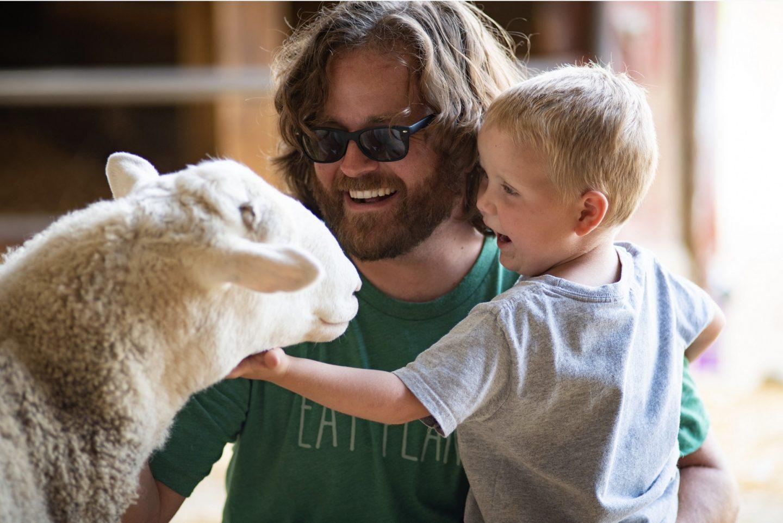 father kid sheep