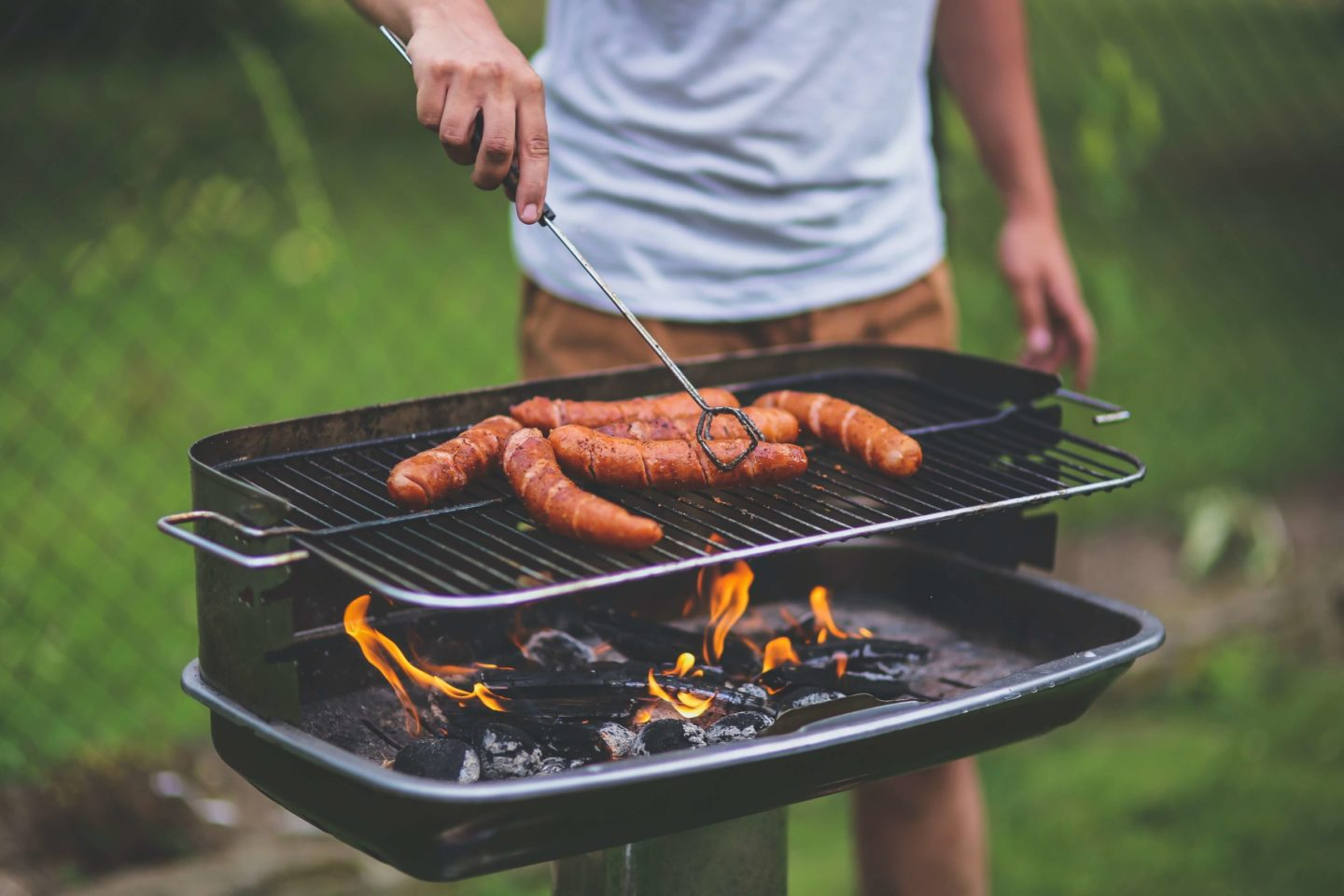 man grilling meat